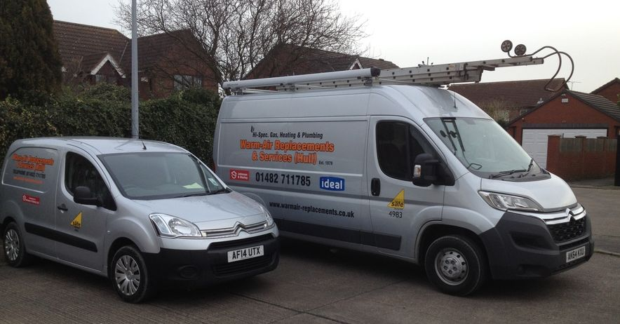 warm air replacements and heating services vans